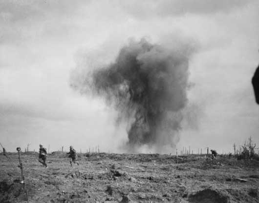 Soldiers running to take shelter from a heavy shellburst at Glencorse Wood in the Ypres salient (AWM E00737).