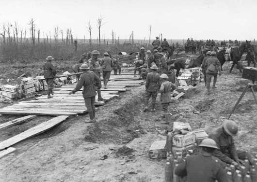 Members of the 2nd Australian Pioneer Battalion making a wagon track from planks of wood at Chateau Wood (AWM E00800).
