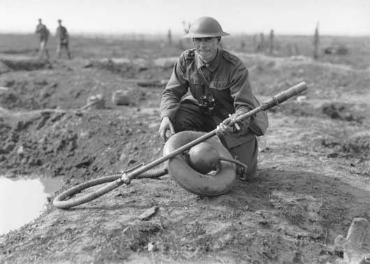 Lieutenant Leslie Bowman Cadell, 6th Battalion, holding a German flame thrower captured near Stirling Castle (AWM E00802).