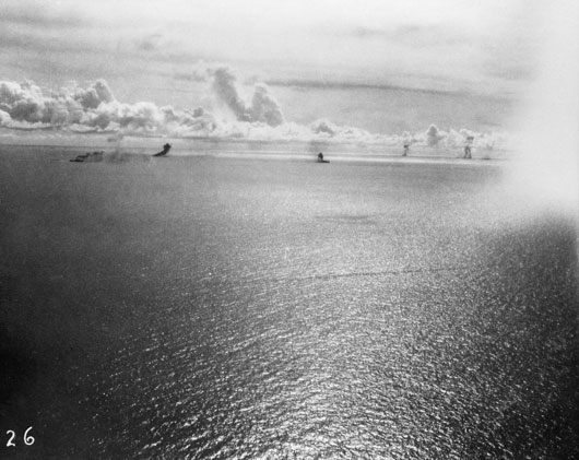 Japanese shipping on fire after an attack by Beaufighter aircraft of 30 Squadron RAAF (AWM P01275.010).