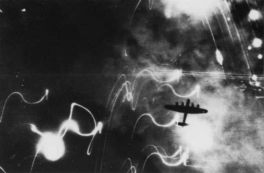 A Lancaster on a night bombing raid on the German city of Hamburg (AWM 044855).