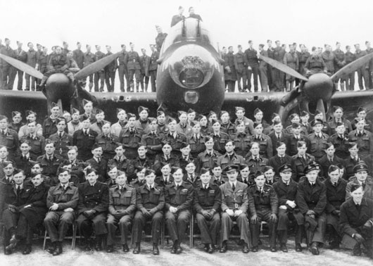A group portrait of air and ground crew members of 460 Squadron RAAF, taken at RAF Station Binbrook in Lincolnshire, England (AWM UK2416).