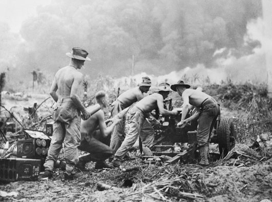 Artillerymen pounding Japanese positions 6000 yards away following the landing at Balikpapan (AWM019437).