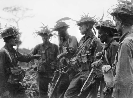 Troops of the 25th Infantry Battalion receiving last minute instructions before an attack on Japanese positions on Pearl Ridge (AWM 077894).