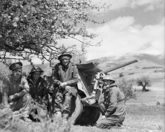 Members of the 1st Anti-Tank Regiment AIF rest after withdrawing from positions on the Monastier Gap, where they occupied one of the most forward positions facing the German onslaught (AWM 007647).