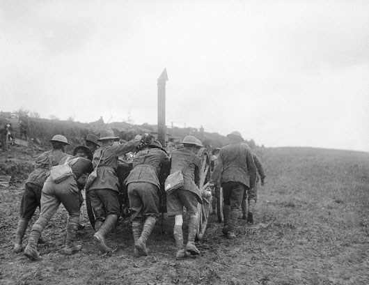 Members of the 6th Brigade bringing one of their field kitchens into position during heavy fighting near Bullecourt (AWM E00437).