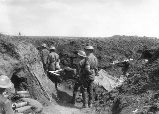 Stretcher bearers carrying the wounded back along the trenches during fighting at Bullecourt (AWM E00440).