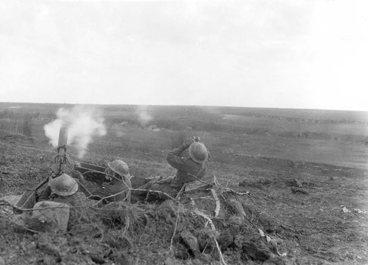 A section of the 22nd Machine Gun Company shooting at a German aircraft flying low over the Bullecourt battlefield (AWM E00458).