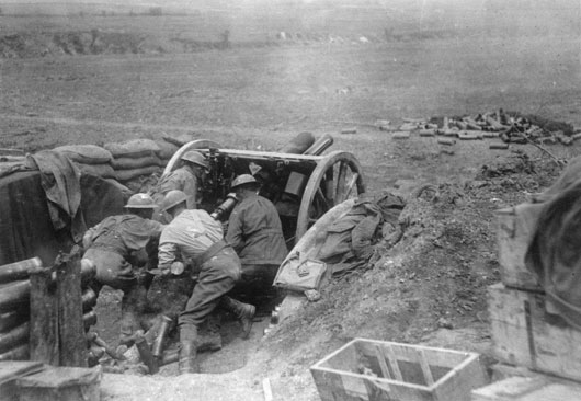 Three members of the Australian Field Artillery using an 18 pounder gun in the battle for Bullecourt (AWM E00600).