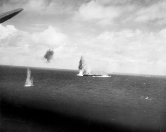 The 30,000-ton Japanese aircraft carrier Shokaku under attack by American aircraft during the Battle of the Coral Sea (AWM 148953).