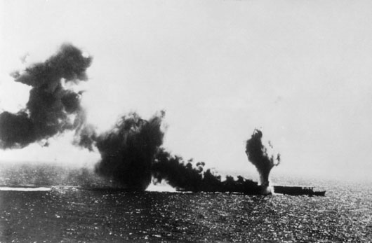 The Japanese aircraft carrier Shoho under attack by US Navy aircraft in the Coral Sea (AWM 157892).