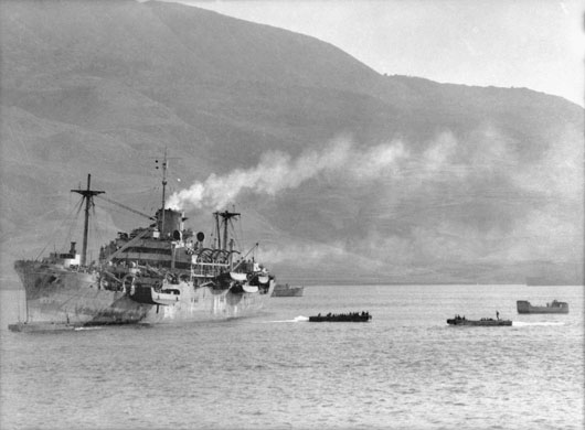 Transport vessels arriving at Suda Bay following the evacuation of Greece (AWM 007810).