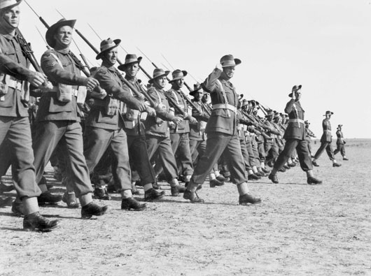 A parade of the entire 9th Australian Division at Gaza airport in December 1942, following the Battle of El Alamein (AWM 050124).