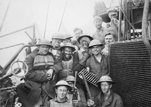 A Breda gun crew of HMAS Perth after a full day fighting off German fighter aircraft in the evacuation from Greece (AWM P01345.016).