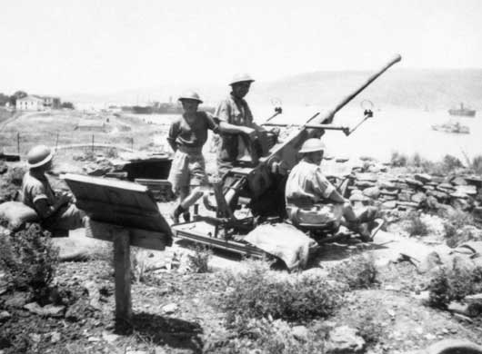 The crew of a 40mm Bofors anti-aircraft gun awaiting the next German aerial attack from a position overlooking Suda Bay (AWM P02053.013).