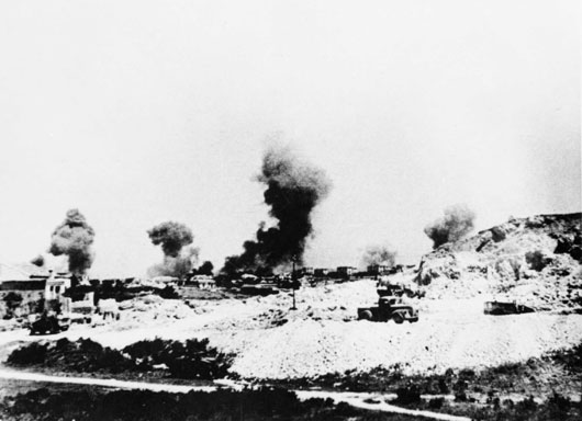 Smoke and dust rising into the air during the German bombing of Heraklion (AWM PO2433.007).