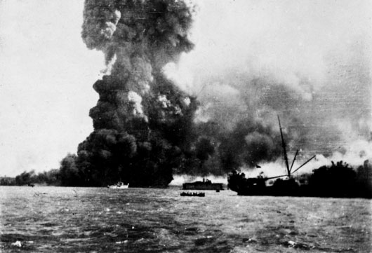 Scenes of destruction during the first Japanese air raid on Darwin Harbour (AWM 134955).