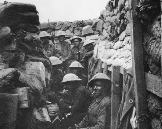 Men of the 53rd Battalion waiting to don their equipment for the attack on Fromelles (AWM A03042).