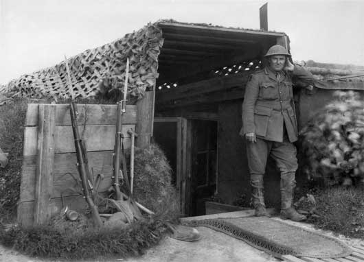Brigadier General H.E. 'Pompey' Elliott, standing at the door of a captured German Divisional Headquarters near Harbonnieres (AWM E02855).