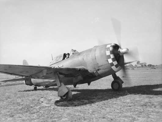RAAF Warrant Officer F.J. Kevin taxies his aircraft of 258 Squadron RAF to a dispersal bay at an advanced airfield in the Arakan, on the Burma front (AWM SEA0046).