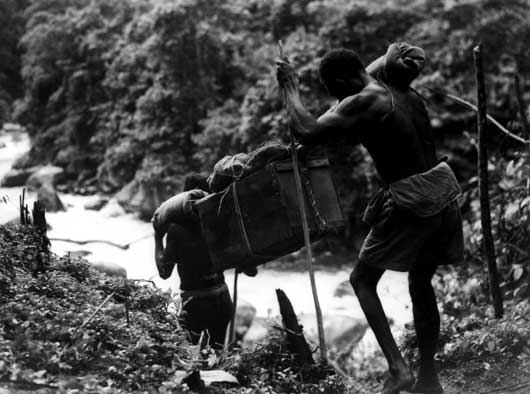 Native bearers, known as 'Fuzzy Wuzzy Angels', walked long distances with heavy loads of supplies and equipment for Australian troops (AWM 013002).
