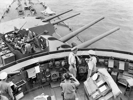The forward 8-inch turrets of HMAS Australia seeking out the enemy in the South West Pacific Area (AWM 017623).