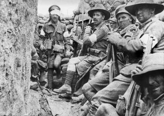 1st Battalion troops waiting near Jacob's Trench for relief by the 7th Battalion (AWM A01005).