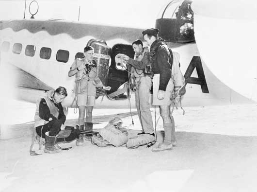 Aircrew of 459 Squadron RAAF check over their gear prior to take-off in their Lockheed Hudson to conduct a covoy patrol over the Mediterranean (AWM MEB0043).