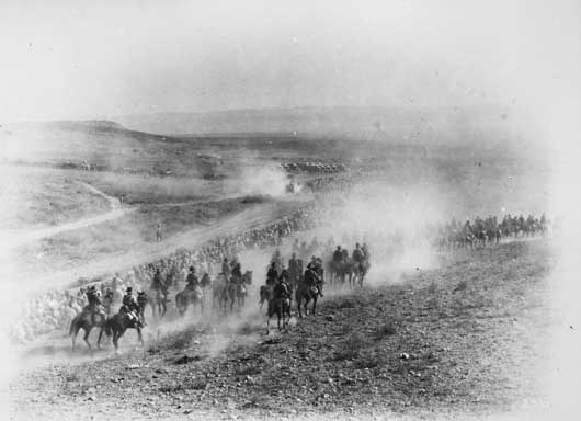 A scene in the dust at Megiddo during the advance on Damascus by the Australian Light Horse (AWM B00256).