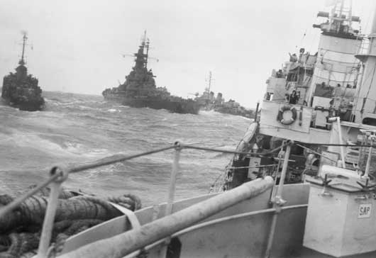A US Navy battleship and escort destroyer photographed from HMAS Norman (AWM 121169).