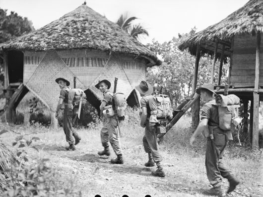 Men of A Company, 14/32nd Infantry Battalion entering Kalampun village (AWM 078376).