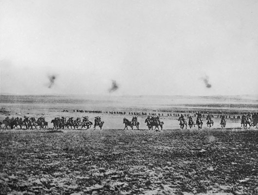 A photograph that has been described as one of the charge of the 4th Light Horse at Beersheba, allegedly taken by a Turk whose camera was later captured (AWM P03723.001).